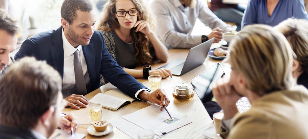 coworkers working at conference table
